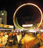 Rollercoaster speeding on wheel. Sibiu, Romania - September 28, 2012: Super Loops or rollercoaster rotating inside a wheel just in front of Council Tower, Sibiu Stock Photo