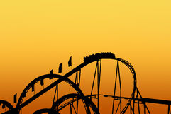 Rollercoaster track on funfair. With sunset backgroud royalty free stock images