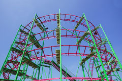 Rollercoaster track rail against a brilliant blue sky. Rollercoaster track against a brilliant blue sky royalty free stock photo
