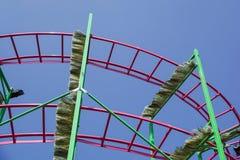 Rollercoaster track rail against a brilliant blue sky. Rollercoaster track against a brilliant blue sky stock photos