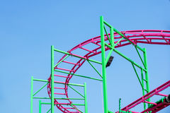 Rollercoaster track rail against a brilliant blue sky. Rollercoaster track against a brilliant blue sky stock image