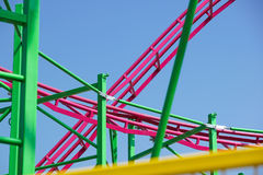 Rollercoaster track rail against a brilliant blue sky. Rollercoaster track against a brilliant blue sky stock images