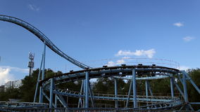 Rollercoaster train is moving along the loop stock footage