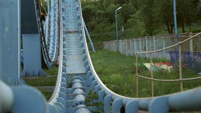 Rollercoaster train is moving along the track stock footage