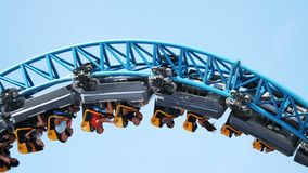 Rollercoaster upside down closeup. Against clear sky stock video footage