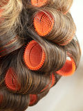 Rollers. Close up of hair twisted on rollers stock photos