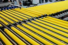 Rollers of conveyer. A conveyer with yellow rollers royalty free stock photography