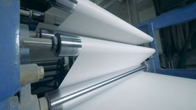 Rollers move white sheets, typographic equipment. stock video
