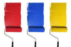 Rollers with Primary Colors. Paint Rollers with primary colors isolated over white background royalty free stock photography