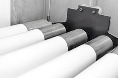 Rollers and roll print paper. Polygraphic process in a modern printing house with rollers and roll print paper stock photography
