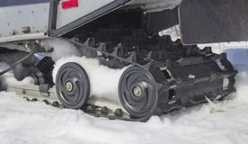 Rollers of the snowmobile stock photo