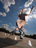 Rollerskater. Wide angle portrait of a training rollerskater Royalty Free Stock Photo