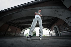 Rollerskater. Wide angle photo of a rollerskater in urban scenery Stock Photos
