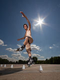 Rollerskater. Wide angle portrait of a rollerskater under hot sun Stock Photo