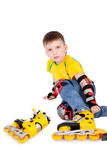 Rollerskater. Cute handsome little boy trying on the roller blades Stock Photos