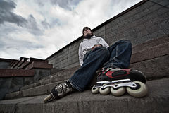 Rollerskater. Wide angle portrait of a serious rollerskating man Royalty Free Stock Photo