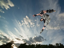 Rollerskater. Ultra wide angle photo of a flying rollerskater - photo with a little natural motion blur Royalty Free Stock Photos