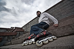 Rollerskater. Wide angle portrait of a serious rollerskating man Stock Photo
