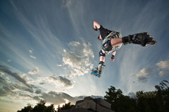 Rollerskater. Ultra wide angle photo of a flying rollerskater - photo with a little natural motion blur Stock Photo