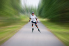 Rollerskater with the rods Royalty Free Stock Images