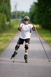Rollerskater with the rods. Man rollerskating with the rods Stock Image