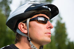 Rollerskater with the rods. Sportsman with a helmet and sunglasses, face close-up Stock Photography