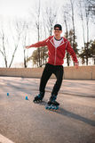 Rollerskater, rollerskating trick exercise in park. Male roller skater leisure on sidewalk Stock Images