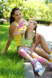 Rollerskaters mom and child Stock Image