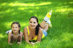 Rollerskaters mom and child Stock Photos