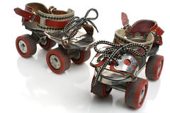 Rollerskates. A pair of vintage roller skates on white Stock Photo