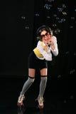 rollerskates géniaux d'écouteurs de fille Images libres de droits