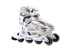 Rollerskates in-linea per i bambini Pattini di rullo sul BAC bianco fotografia stock libera da diritti