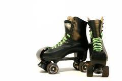 Rollerskates neri Immagine Stock