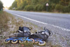 Rollerskates on roadside Stock Photos