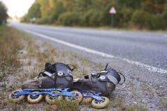 Rollerskates on roadside. Hi-speed rollerskates on roadside in non-urban area stock photos