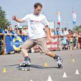 Rollerskating сompetition. MOSCOW - JULY 31: Luzhniki Olympic arena, Kiryll Ryazantsev performs a Compass slalom element - Annual Russian Rollerskating royalty free stock photography