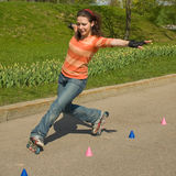 Rollerskating Girl. Outdoors on Green Background Stock Image