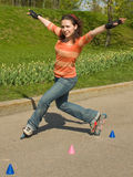 Rollerskating Girl. Outdoors on Green Background Stock Photos