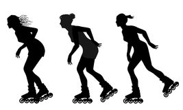 Rollerskating silhouettes - vector Stock Images