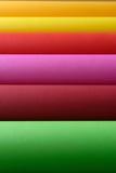 Rolles do papel colorido em amarelo e em alaranjado verdes, marrons, cor-de-rosa, vermelhos Fotografia de Stock Royalty Free