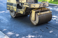 Rolling Asphalt on a Driveway Stock Photos