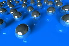 Rolling balls on blue Stock Photo