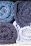 rolling blue towel on white shelf Royalty Free Stock Photography