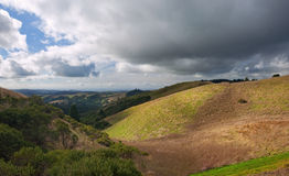 Rolling California Hillside. Scenic rolling grassland hills of coastal central california under moody skies Stock Photography