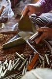 Rolling cheroot cigars Stock Photo
