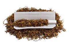 Rolling cigarette and tobacco Stock Photo