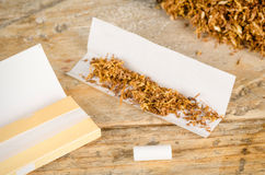 Rolling cigarettes Royalty Free Stock Image