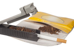 Rolling of cigarettes Royalty Free Stock Image