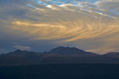 Rolling clouds above mountains before sunset, Aoraki Mount Cook National Park, New Zealand Royalty Free Stock Photography