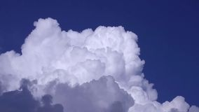 Rolling clouds in the blue sky stock footage